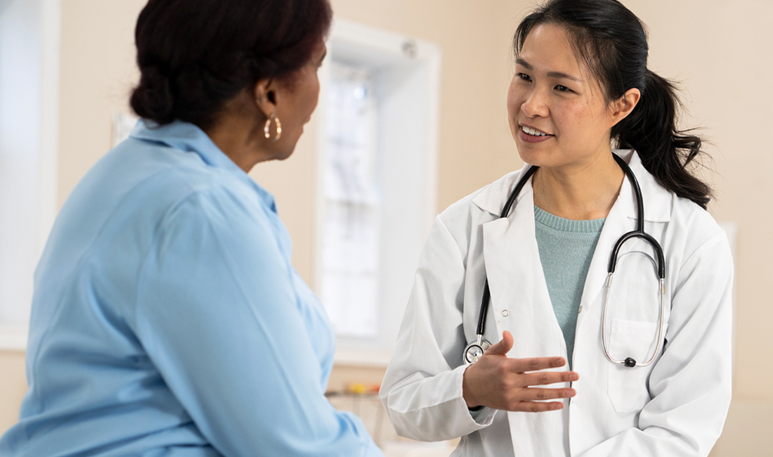 A woman talking with her primary care physician