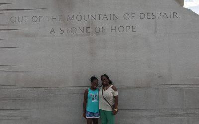 women in front of MLK memorial