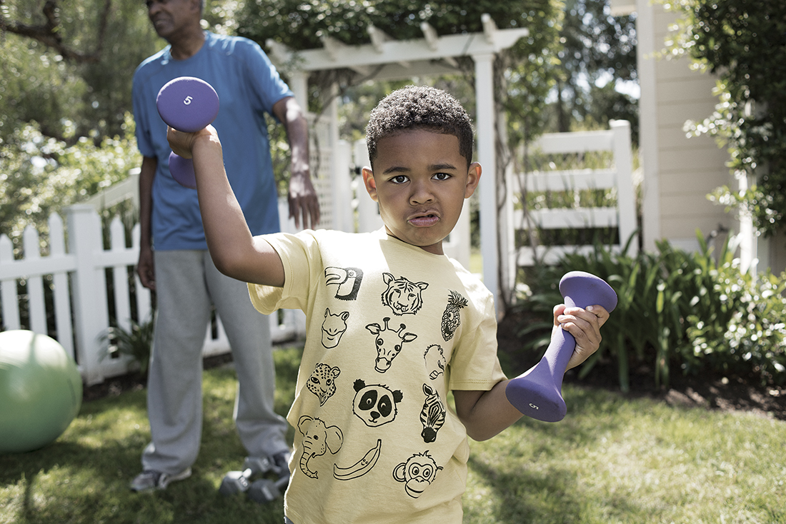 boy working out with family