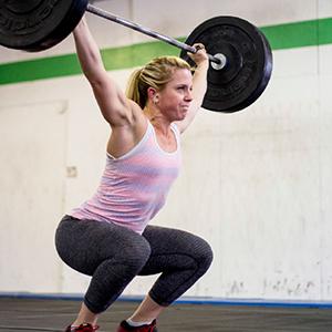 Kim lifting weights