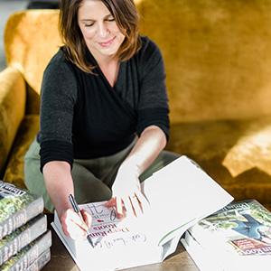 Vivian signing her books